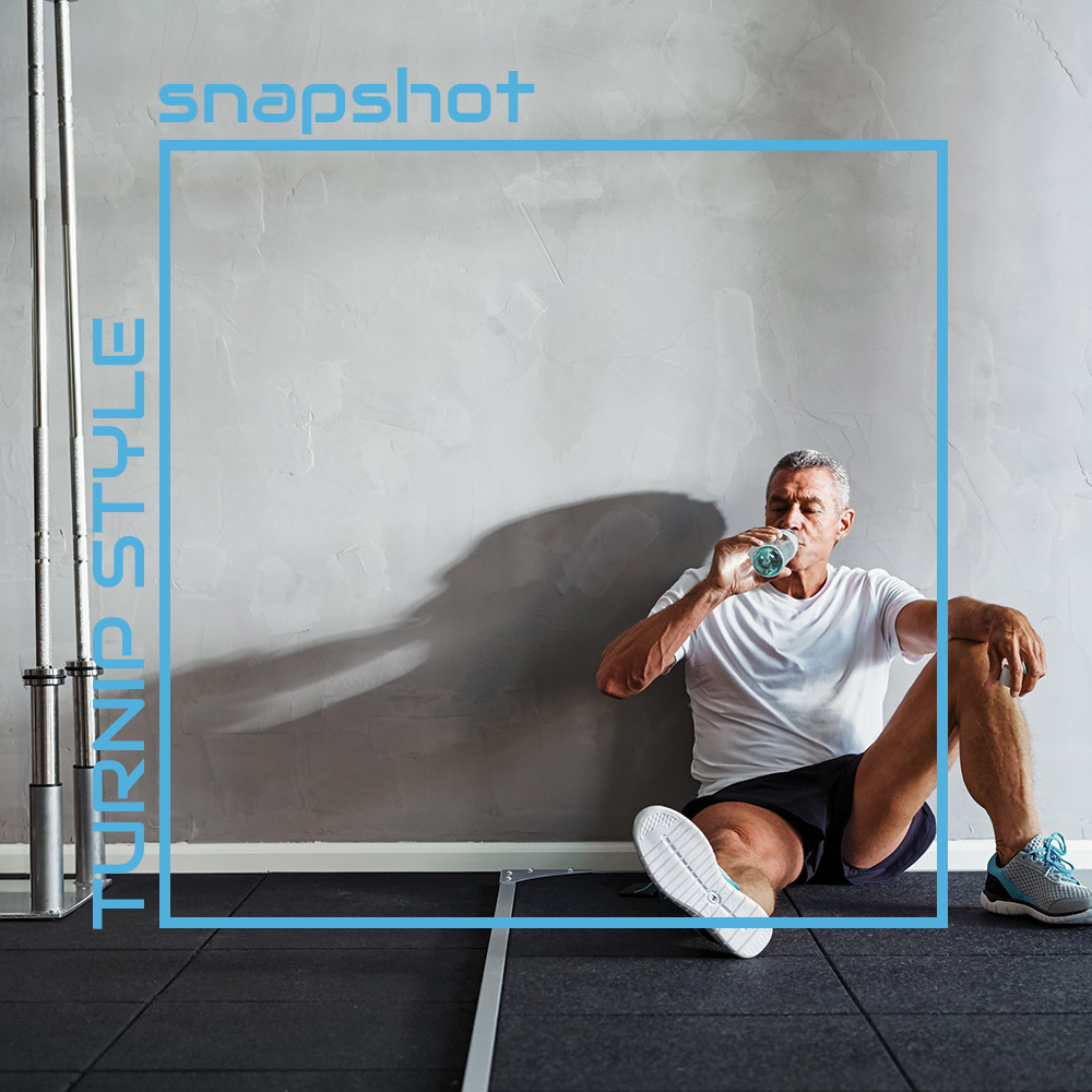 mature gentleman drinking water after a workout - sadly we cant quite see up his shorts...